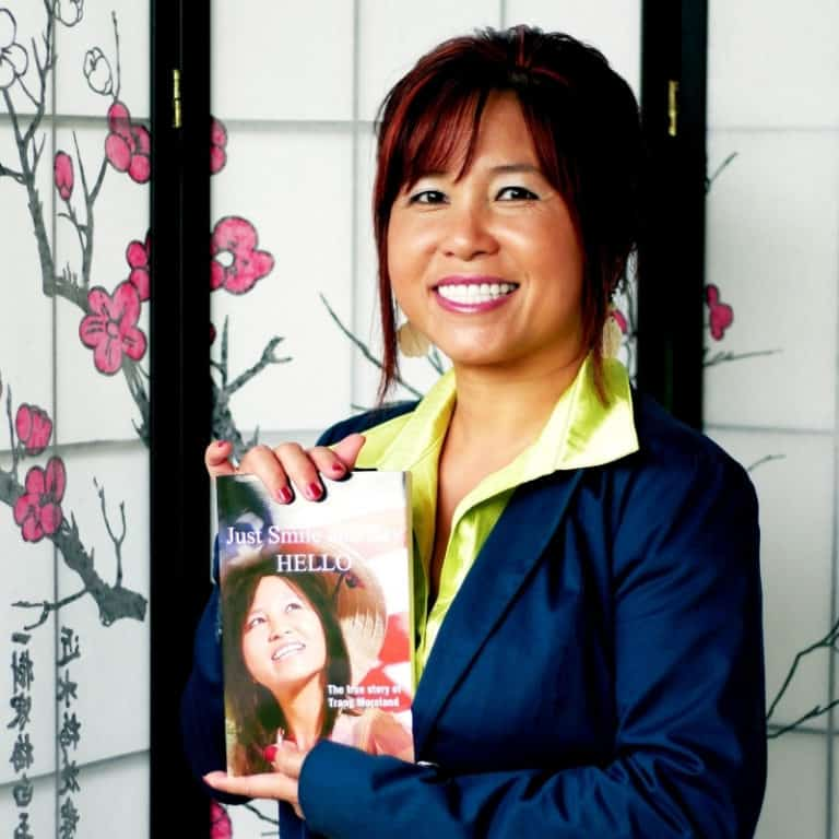 trang moreland holding book just smile and say hello